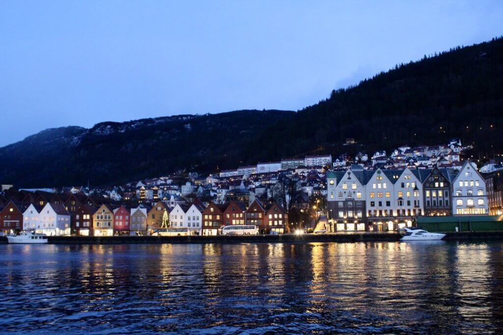 Night-time in Bergen, Norway, looking across the water at the gorgeous Hanseatic League houses after a fresh snowfall.